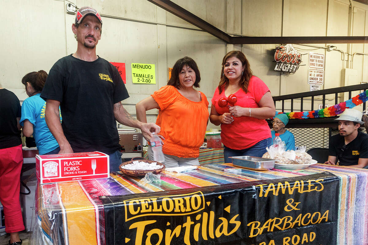 Walter Stevens (from left), Anno Porto and Diana Valague man the Celorio Tortillas booth at the Barbacoa & Big Red Fall Festival 2013 at the R & J Music Pavilion, 18086 Pleasanton Rd, on Sunday, Oct. 13, 2013. MARVIN PFEIFFER/ mpfeiffer@express-news.net