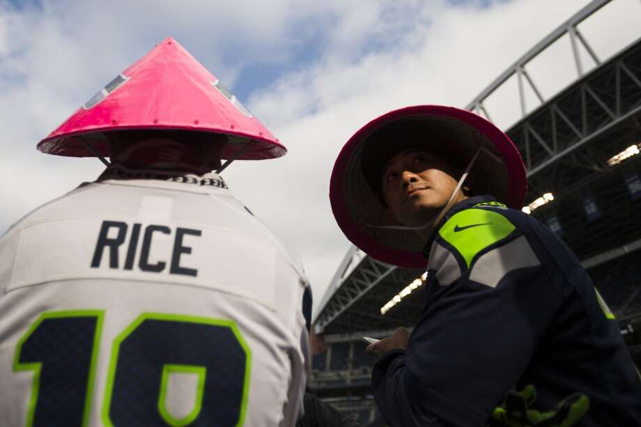 Sidney Rice fans sporting custom pink hats await the beginning of a game against the Tennessee Titans Sunday, Oct. 13, 2013, at CenturyLink Field in Seattle.(Jordan Stead, seattlepi.com) Photo: JORDAN STEAD, SEATTLEPI.COM