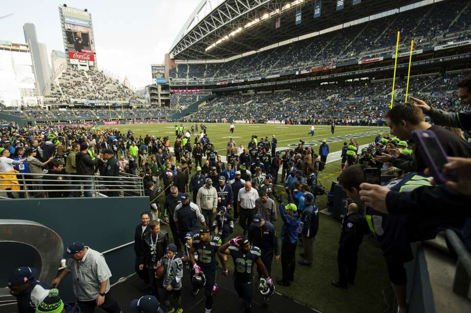 Screaming from the seats, fans watch the Seahawks retreat to the locker room before the beginning of a game against the Tennessee Titans Sunday, Oct. 13, 2013, at CenturyLink Field in Seattle. (Jordan Stead, seattlepi.com) Photo: JORDAN STEAD, SEATTLEPI.COM