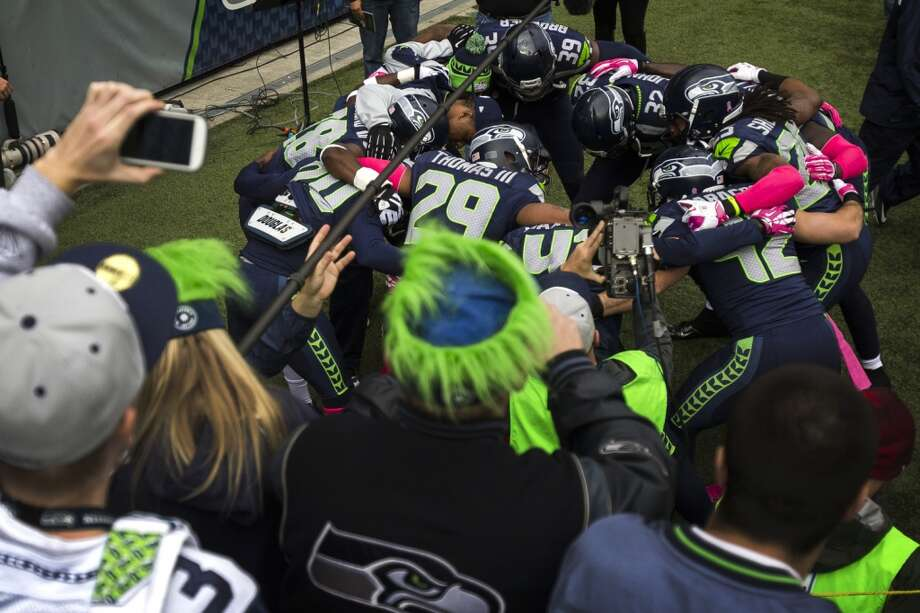 Seahawks huddle and get hyped up before a game against the Tennessee Titans Sunday, Oct. 13, 2013, at CenturyLink Field in Seattle. (Jordan Stead, seattlepi.com) Photo: JORDAN STEAD, SEATTLEPI.COM