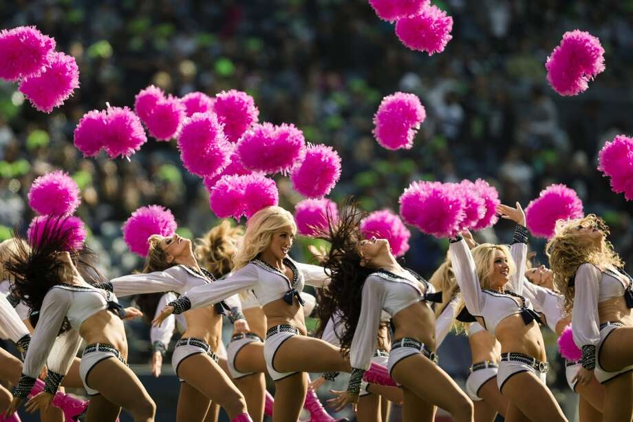 The Sea Gals abandon their pink pom poms during a performance in first half of a Seahawks game against the Tennessee Titans Sunday, Oct. 13, 2013, at CenturyLink Field in Seattle. The Titans led the Seahawks 10-7 at the half. (Jordan Stead, seattlepi.com) Photo: JORDAN STEAD, SEATTLEPI.COM