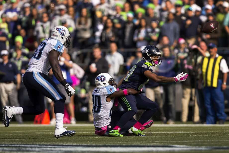 Seattle's Golden Tate, right, fails to catch a pass from Russell Wilson during the first half of a game against the Tennessee Titans Sunday, Oct. 13, 2013, at CenturyLink Field in Seattle. The Titans led the Seahawks 10-7 at the half. (Jordan Stead, seattlepi.com) Photo: JORDAN STEAD, SEATTLEPI.COM