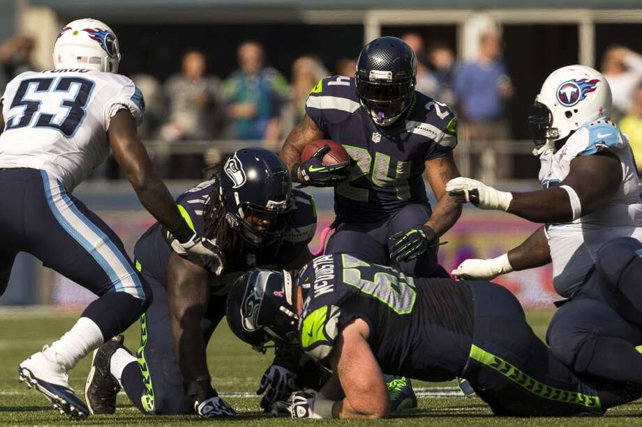 Seattle's running back Marshawn Lynch, center, looks for a way over a pile of teammates and Tennessee Titans during the first half of a game Sunday, Oct. 13, 2013, at CenturyLink Field in Seattle. The Titans led the Seahawks 10-7 at the half. (Jordan Stead, seattlepi.com) Photo: JORDAN STEAD, SEATTLEPI.COM