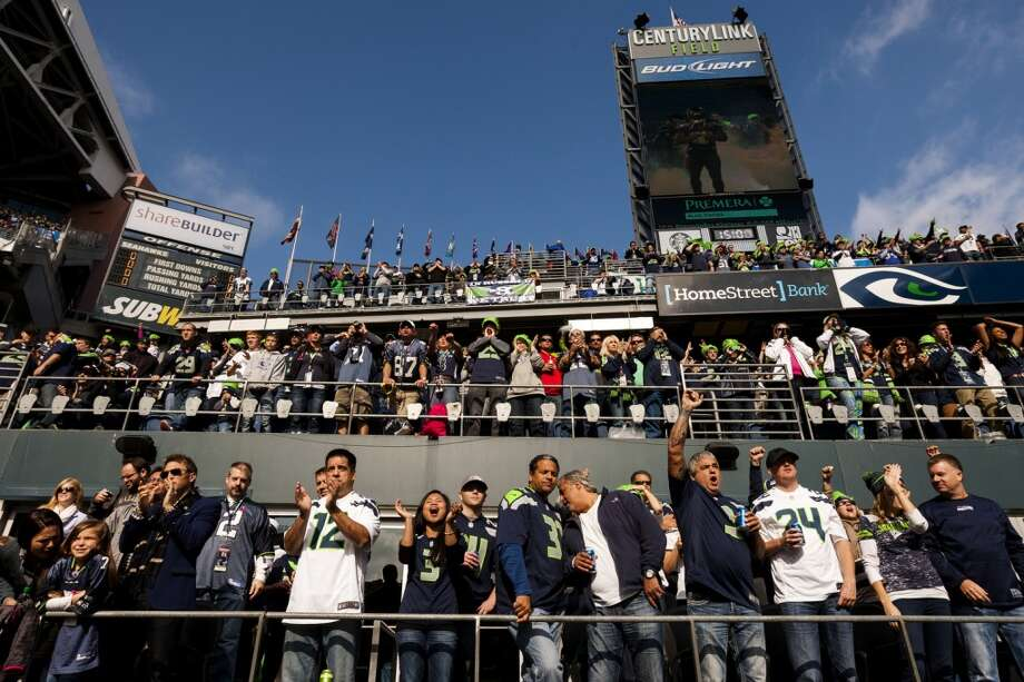 Fans cheer during the first half of a game Sunday, Oct. 13, 2013, at CenturyLink Field in Seattle. The Titans led the Seahawks 10-7 at the half. (Jordan Stead, seattlepi.com) Photo: JORDAN STEAD, SEATTLEPI.COM