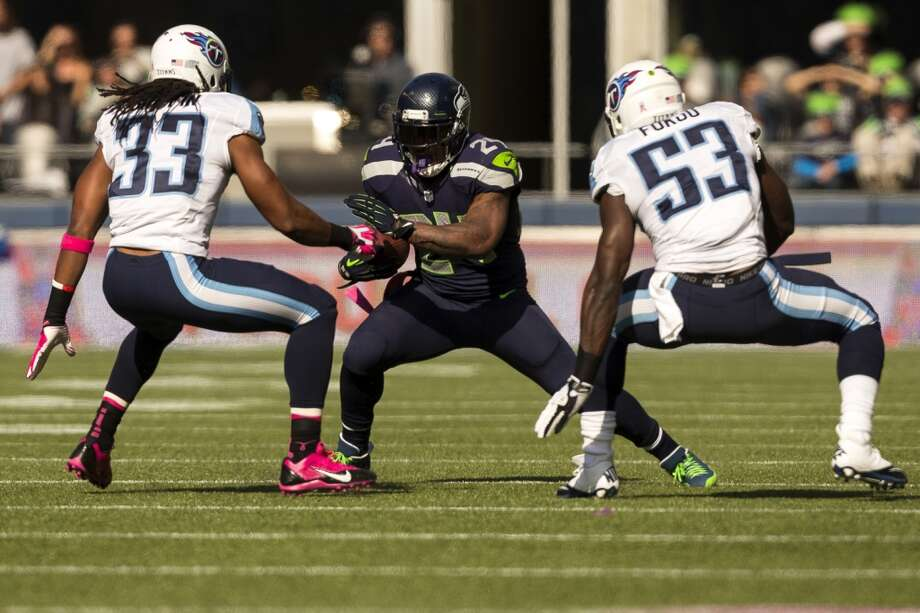 Seattle's running back Marshawn Lynch, center, searches for a hole in Tennessee Titan defense during the first half of a game Sunday, Oct. 13, 2013, at CenturyLink Field in Seattle. The Titans led the Seahawks 10-7 at the half. (Jordan Stead, seattlepi.com) Photo: JORDAN STEAD, SEATTLEPI.COM