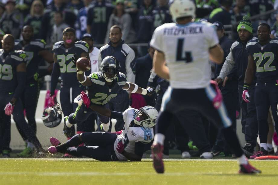 Seattle's Walter Thurmond, top left, bats an opponent's pass from the air during the first half of a game Sunday, Oct. 13, 2013, at CenturyLink Field in Seattle. The Titans led the Seahawks 10-7 at the half. (Jordan Stead, seattlepi.com) Photo: JORDAN STEAD, SEATTLEPI.COM