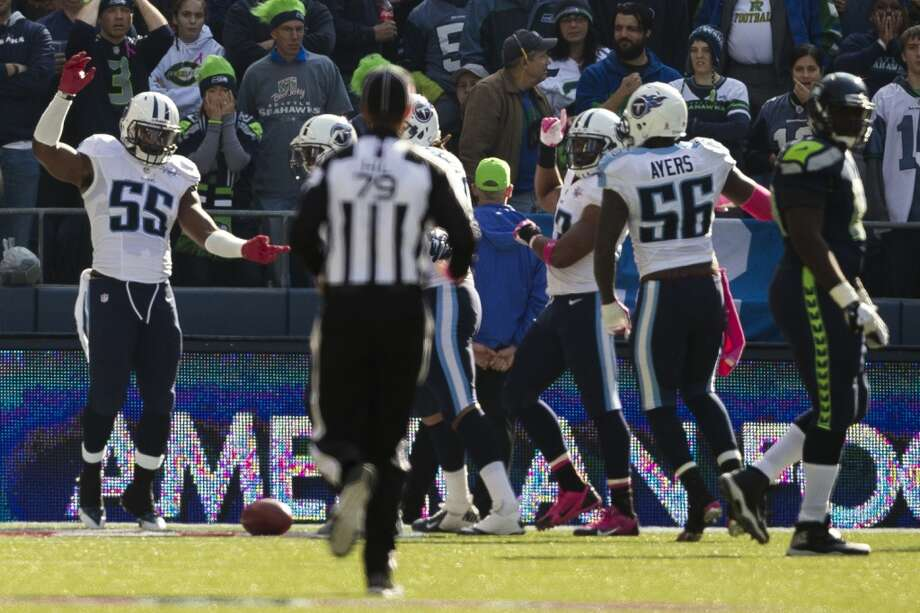 Tennessee Titans celebrate a touchdown after scooping up a fumbled Seahawk ball during the first half of a game Sunday, Oct. 13, 2013, at CenturyLink Field in Seattle. The Titans led the Seahawks 10-7 at the half. (Jordan Stead, seattlepi.com) Photo: JORDAN STEAD, SEATTLEPI.COM