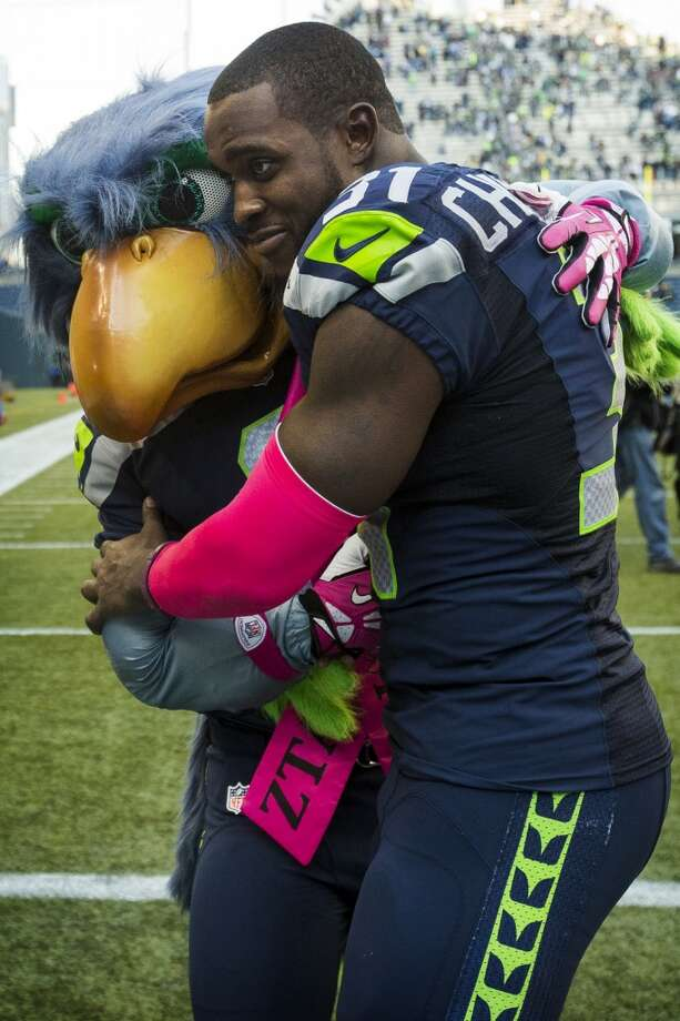 Seattle's Kam Chancellor, right, embraces the Seattle Seahawk mascot following a game against the Tennessee Titans Sunday, Oct. 13, 2013, at CenturyLink Field in Seattle. The Seahawks beat the Titans 20-13. (Jordan Stead, seattlepi.com) Photo: JORDAN STEAD, SEATTLEPI.COM