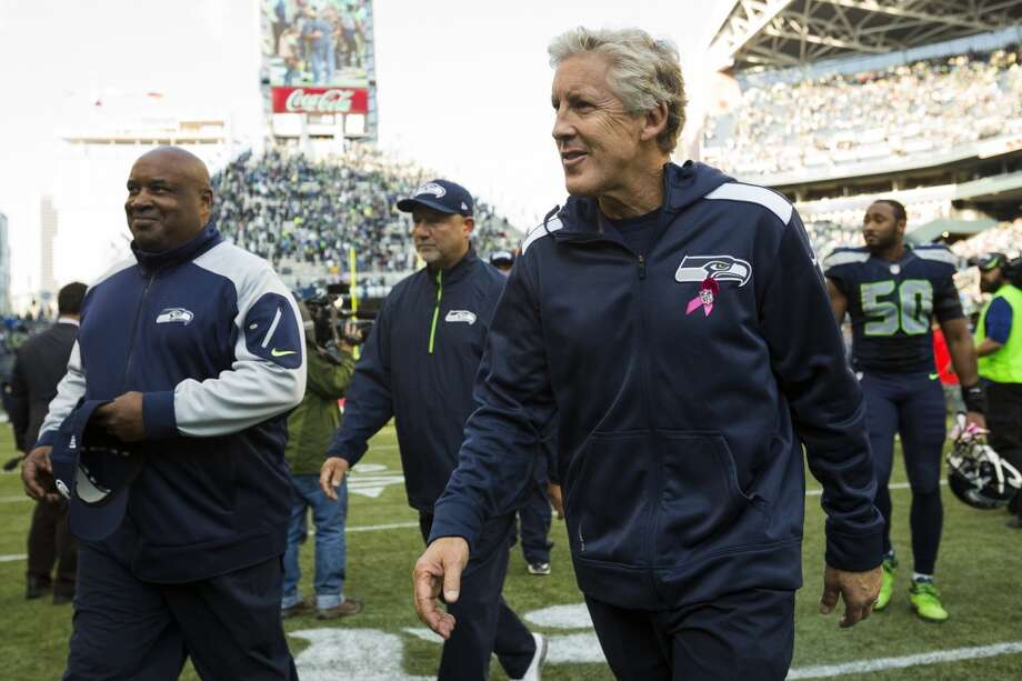 Seattle Seahawks head coach Pete Carroll, right, leaves the field following a game against the Tennessee Titans Sunday, Oct. 13, 2013, at CenturyLink Field in Seattle. The Seahawks beat the Titans 20-13. (Jordan Stead, seattlepi.com) Photo: JORDAN STEAD, SEATTLEPI.COM
