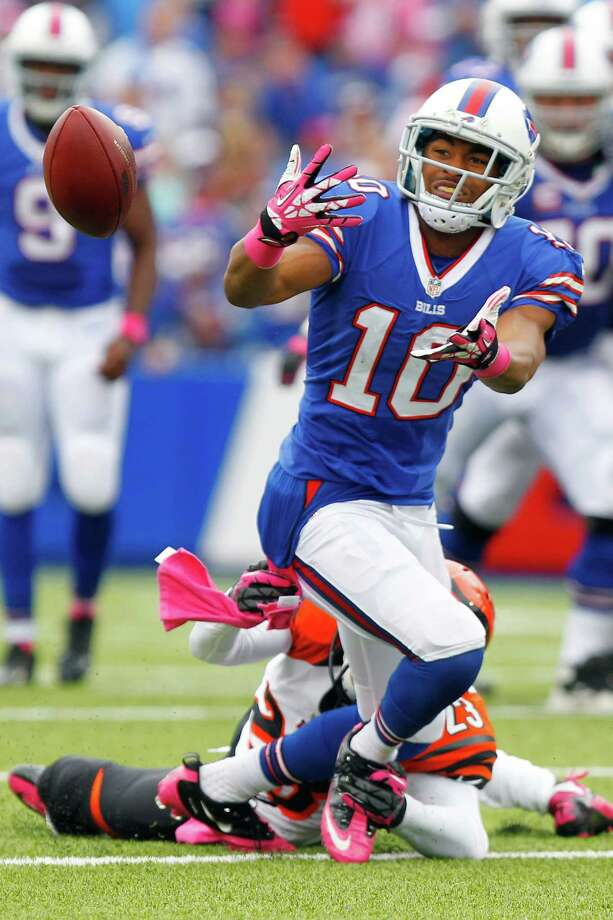 Buffalo Bills wide receiver Robert Woods (10) can't get a handle on a pass as Cincinnati Bengals cornerback Terence Newman (23) covers in the second quarter of the NFL football game on Sunday, Oct. 13, 2013, in Orchard Park, N.Y. (AP Photo/Bill Wippert) ORG XMIT: NYKS127 Photo: Bill Wippert / FR170745 AP