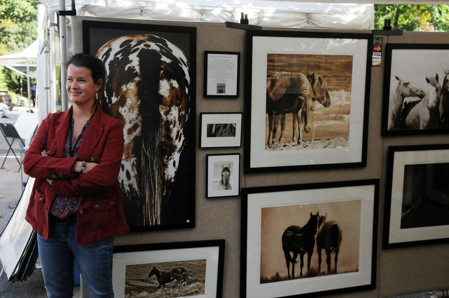 Photographer Caroline Christie and her horse photographs at the Bruce Museum's 32nd Annual Outdoor Arts Festival featuring more than 85 artists from all over the country at the Bruce Museum in Greenwich, Conn., Oct. 12, 2013. Photo: Keelin Daly / Stamford Advocate Freelance