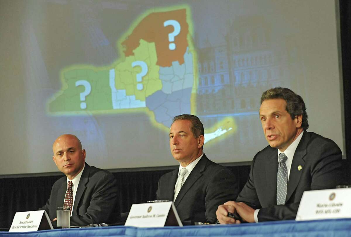 Governor Andew Cuomo, right, holds a press conference to discuss proposals on upstate casinos on Thursday, May 9, 2013 in Albany, N.Y. Also sitting with the governor are Steve Acquario, NYS Association of Counties, left, and Howard Glaser, Director of State Operations. (Lori Van Buren / Times Union)