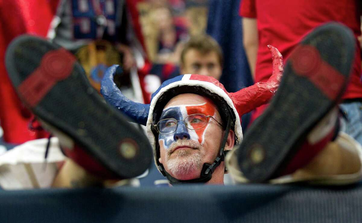 Houston Texans fan Chris Lockeridge sits back in his seat as he reacts to the Texans loss to the St. Louis Rams at Reliant Stadium on Sunday, Oct. 13, 2013, in Houston. ( Brett Coomer / Houston Chronicle )