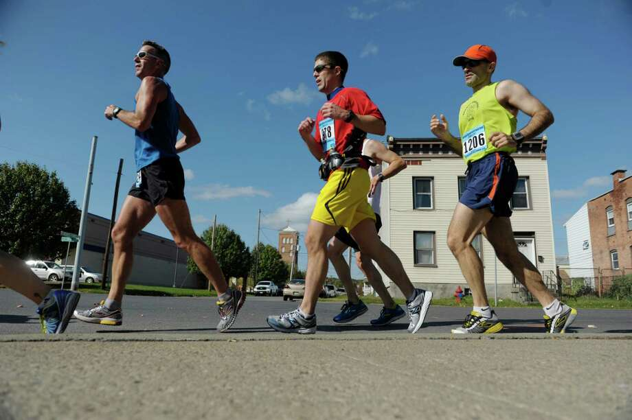 Runners make their way along 2nd Ave. during the Mohawk Hudson River Marathon on Sunday, Oct. 13, 2013 in Watervliet, NY.  The marathon started in Schenectady and ended in Albany.     (Paul Buckowski / Times Union) Photo: Paul Buckowski / 00024202A