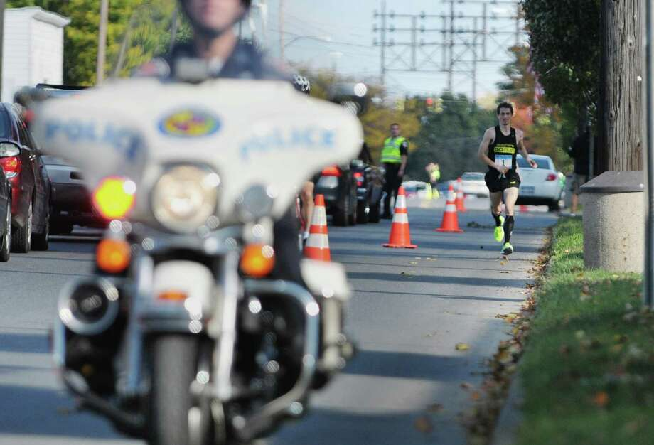 Bryan Morseman from Addison, NY leads all the other runners as he heads along 2nd Ave.  during the Mohawk Hudson River Marathon on Sunday, Oct. 13, 2013 in Watervliet, NY.  The marathon started in Schenectady and ended in Albany.       (Paul Buckowski / Times Union) Photo: Paul Buckowski / 00024202A