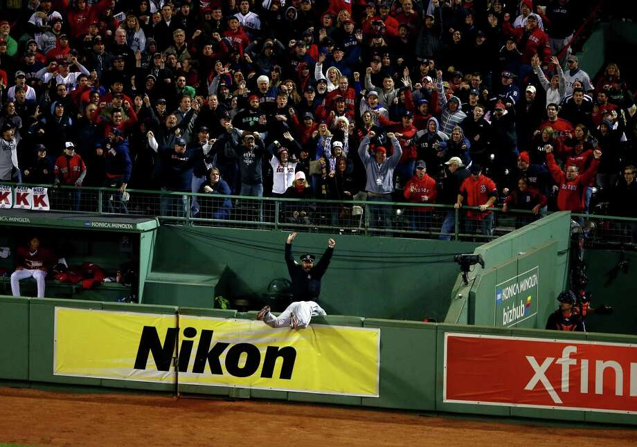 BOSTON, MA - OCTOBER 13:  Torii Hunter #48 of the Detroit Tigers tries to catch a grand slam hit by David Ortiz #34 of the Boston Red Sox in the eighth inning of Game Two of the American League Championship Series at Fenway Park on October 13, 2013 in Boston, Massachusetts.  (Photo by Al Bello/Getty Images) ORG XMIT: 184446607 Photo: Al Bello / 2013 Getty Images