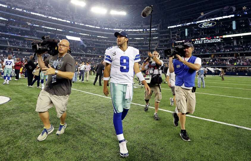 Dallas Cowboys' Tony Romo walks off the field after the game with the Washington Redskins during sec