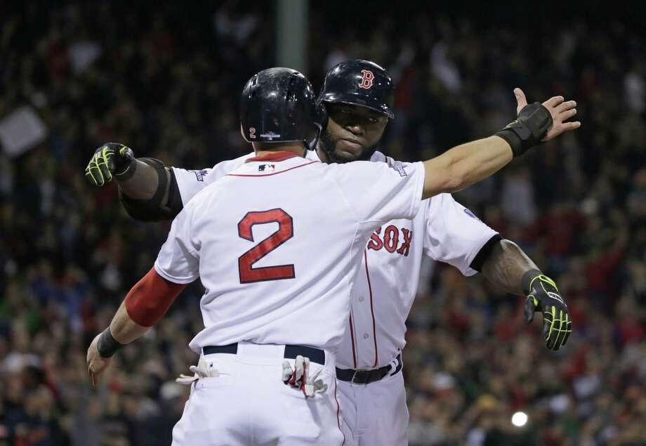 Red Sox designated hitter David Ortiz celebrates with Jacoby Ellsbury (2) after hitting a grand slam that tied Game 2 of the ALCS in the eighth inning. Photo: Charles Krupa / Associated Press