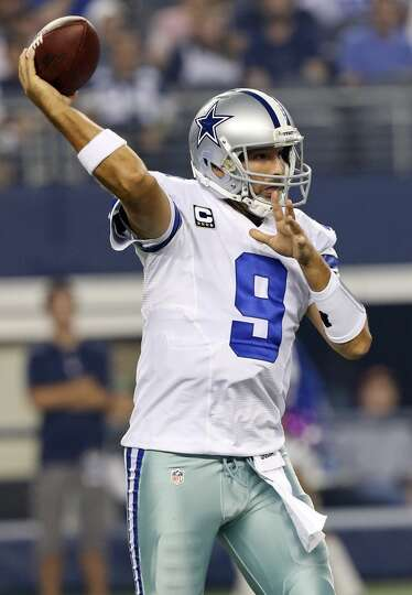 Dallas Cowboys' Tony Romo passes against the Washington Redskins during first half action Sunday Oct