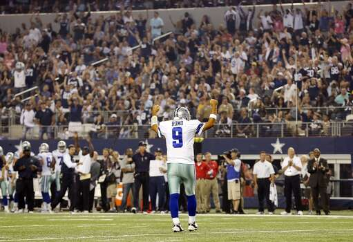 Dallas Cowboys' Tony Romo reacts after teammate DeMarco Murray (not pictured) scored a touchdown against the Washington Redskins during first half action Sunday Oct. 13, 2013 at AT&T Stadium in Arlington, Tx. Photo: Edward A. Ornelas, Edward A. Ornelas/Express-News