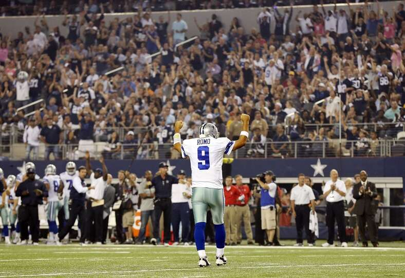 Dallas Cowboys' Tony Romo reacts after teammate DeMarco Murray (not pictured) scored a touchdown aga