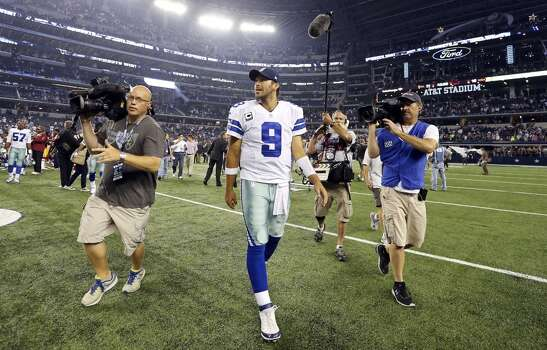 Dallas Cowboys' Tony Romo walks off the field after the game with the Washington Redskins during second half action Sunday Oct. 13, 2013 at AT&T Stadium in Arlington, Tx. The Cowboys won 31-16. Photo: Edward A. Ornelas, Edward A. Ornelas/Express-News