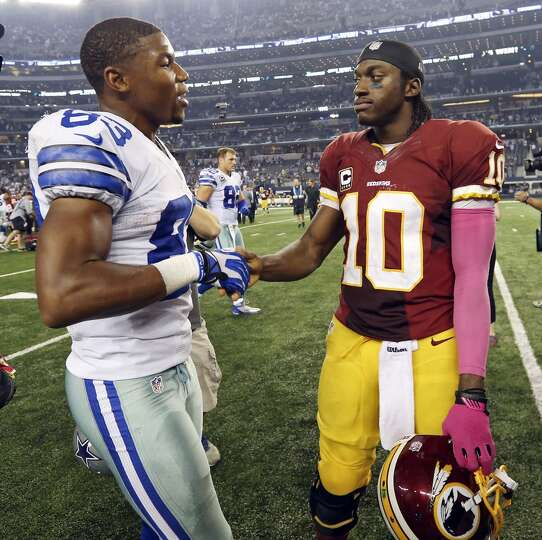 Dallas Cowboys' Terrance Williams talks with Washington Redskins' Robert Griffin III after the the g