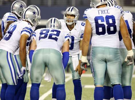 Dallas Cowboys' Tony Romo huddles with teammates during first half action against the Washington Redskins Sunday Oct. 13, 2013 at AT&T Stadium in Arlington, Tx. Photo: Edward A. Ornelas, Edward A. Ornelas/Express-News