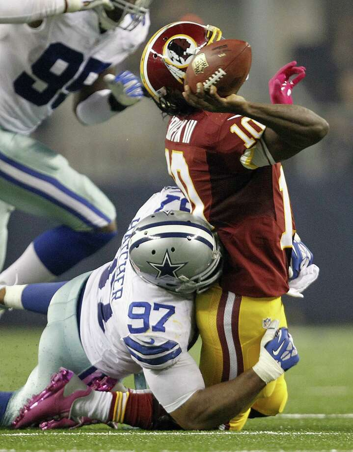 Cowboys defensive end Jason Hatcher makes sure the elusive Robert Griffin III doesn't get away, one of three sacks of the Redskins quarterback. Photo: Ron Jenkins, MBR / Fort Worth Star-Telegram