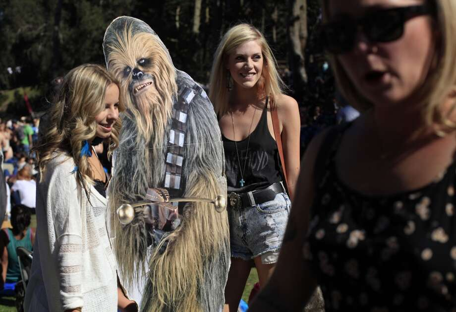 Natalie Andrews and Serena Rafferty, of San Francisco pose with ChewbaccaSF at Hardly Strictly Bluegrass in San Francisco, Calf. Photo: Mike Kepka, The Chronicle