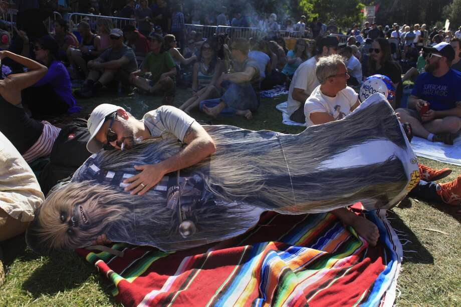 Brian Lilla hugs ChewbaccaSF at Hardly Strictly Bluegrass in San Francisco, Calf. Photo: Mike Kepka, The Chronicle