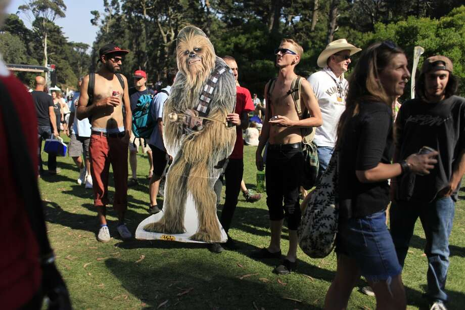 With the help of their roommates, ChewbaccaSF and Scott Renner navigate Hardly Strictly Bluegrass in San Francisco, Calf. Photo: Mike Kepka, The Chronicle