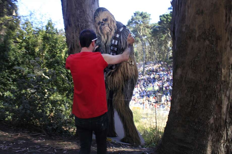 Scott Renner thinks about a potential instagram shot for chewbaccaSF near the Rooster Stage at Hardly Strictly Bluegrass in San Francisco, Calf. Photo: Mike Kepka, The Chronicle