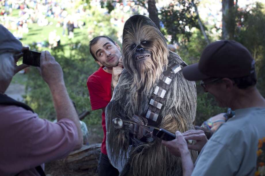 ChewbaccaSF and Scott Renner pose for a couple of a out-of-towners at Hardly Strictly Bluegrass in San Francisco, Calf. Photo: Mike Kepka, The Chronicle
