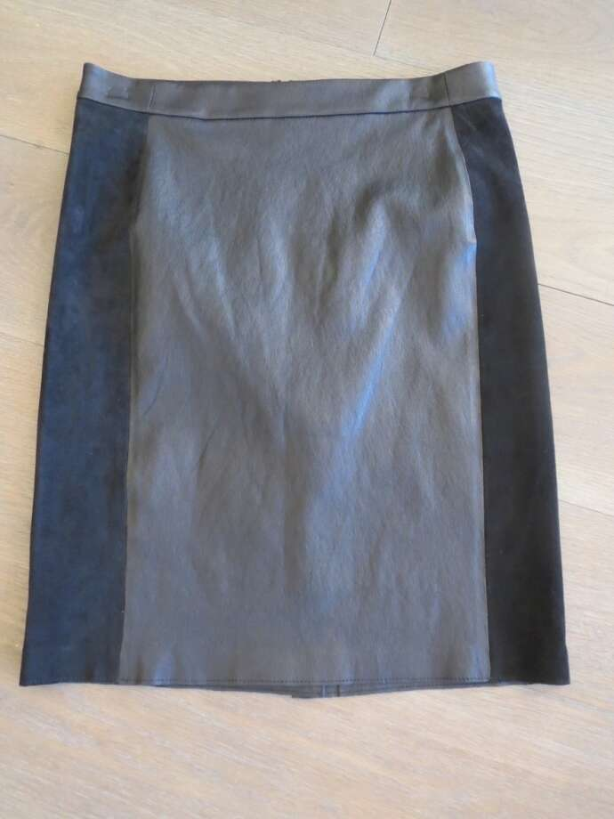 A leather pencil skirt is an investment piece that you'll wear for years.  The classic style features stretch suede for a super-flattering fit and color blocking for a slimming effect.