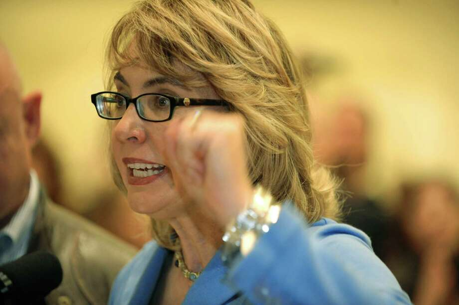 Former U.S. Rep. Gabby Giffords addresses the media during a press conference at the Saratoga Springs Arms Fair on Sunday, Oct. 13, 2013 in Saratoga Springs, NY.     (Paul Buckowski / Times Union) Photo: Paul Buckowski / 00024253A