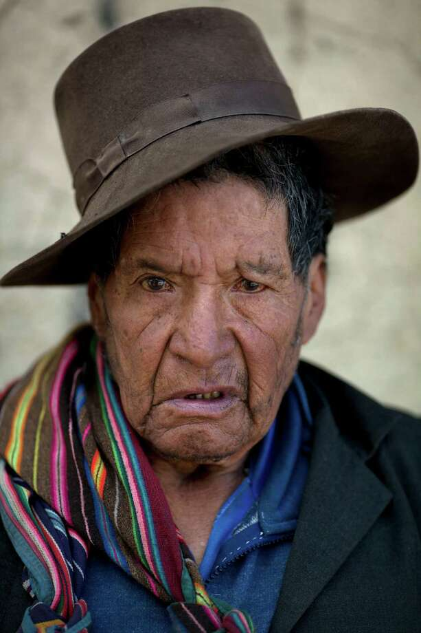 "Pedro Vega Yucra, 80, stands for a photo in Chacas, a small village in Ayacucho, Peru, on Saturday, June 15, 2013. When asked: As you grow older, what are you most afraid of and what is the biggest problem facing the elderly in your country? Yucra said ""I only have a small house. I have no land to work so I have no money. I live alone because my three children live far away, and my wife died years ago. So my biggest fear is that one day I will not have anything to eat or even the energy to work on my own. In the rural areas of my country, we, the elderly, die and nobody notices. We eat alone, we sleep alone, the government should take care of us, but as you become old, no one cares."" Photo: Rodrigo Abd, AP / AP"