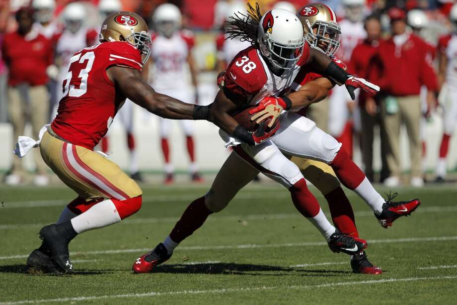 Andre Ellington is stopped short of a first down by NaVorro Bowman and Patrick Willis in the second quarter. The San Francisco 49ers played the Arizona Cardinals at Candlestick Park in San Francisco, Calif., on Sunday, October 13, 2013. Photo: Carlos Avila Gonzalez, The Chronicle