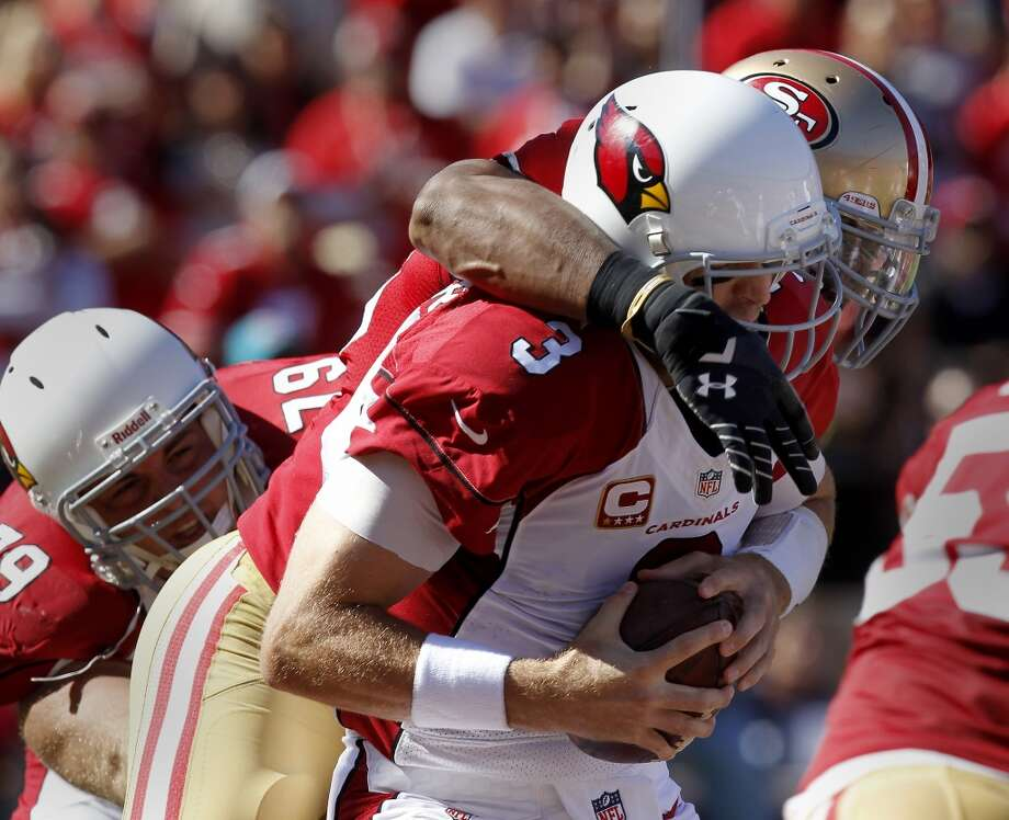 Carson Palmer (3) is sacked by Corey Lemonier (96) for a safety in the first half Sunday October 13, 2013 in San Francisco, Calif. The San Francisco 49ers vs the Arizona Cardinals at Candlestick Park. Photo: Brant Ward, The Chronicle