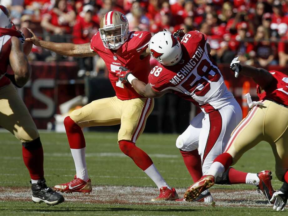 Colin Kaepernick gets caught for a sack in the second quarter Sunday October 13, 2013 in San Francisco, Calif. The San Francisco 49ers vs the Arizona Cardinals at Candlestick Park. Photo: Brant Ward, The Chronicle