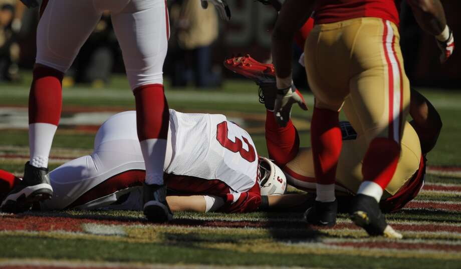 Carson Palmer is sacked by Corey Lemonier in the end zone in the second quarter. The San Francisco 49ers played the Arizona Cardinals at Candlestick Park in San Francisco, Calif., on Sunday, October 13, 2013. Photo: Carlos Avila Gonzalez, The Chronicle