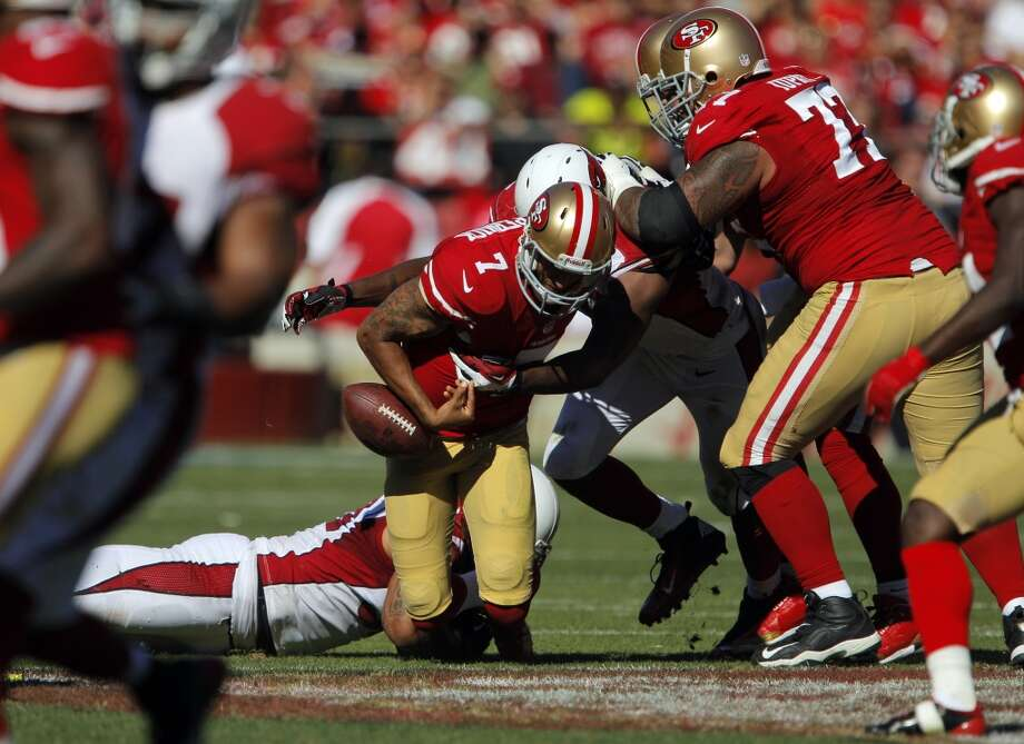 Colin Kaepernick is sacked and fumbles the ball in the second quarter. The San Francisco 49ers played the Arizona Cardinals at Candlestick Park in San Francisco, Calif., on Sunday, October 13, 2013. Photo: Carlos Avila Gonzalez, The Chronicle