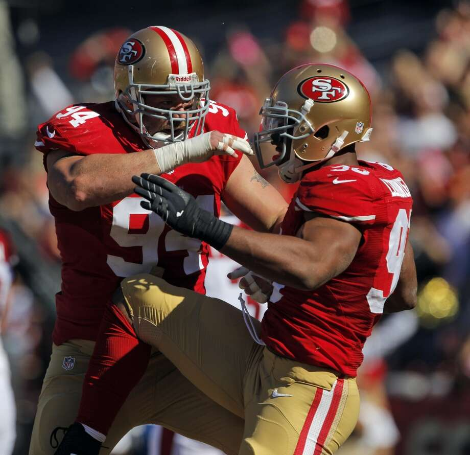 Justin Smith and Corey Lemonier celebrate Lemonier's second quarter safety of Carson Palmer. The San Francisco 49ers played the Arizona Cardinals at Candlestick Park in San Francisco, Calif., on Sunday, October 13, 2013. Photo: Carlos Avila Gonzalez, The Chronicle