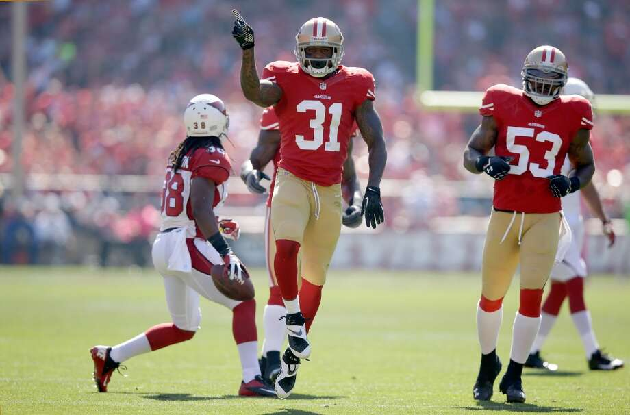 Donte Whitner #31 of the San Francisco 49ers celebrates after he stopped Andre Ellington #38 of the Arizona Cardinals short of a first down at Candlestick Park on October 13, 2013 in San Francisco, California. Photo: Ezra Shaw, Getty Images