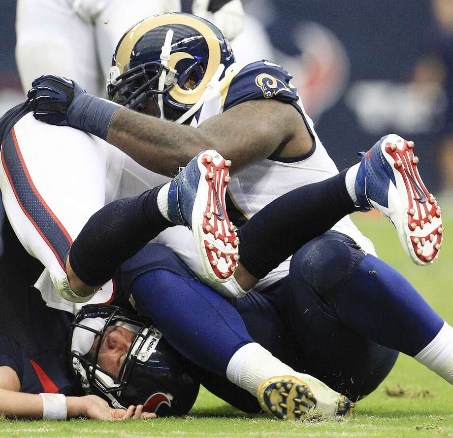 Texans quarterback Matt Schaub gets sacked by Rams defensive tackle Michael Brockers. Photo: Karen Warren, Houston Chronicle