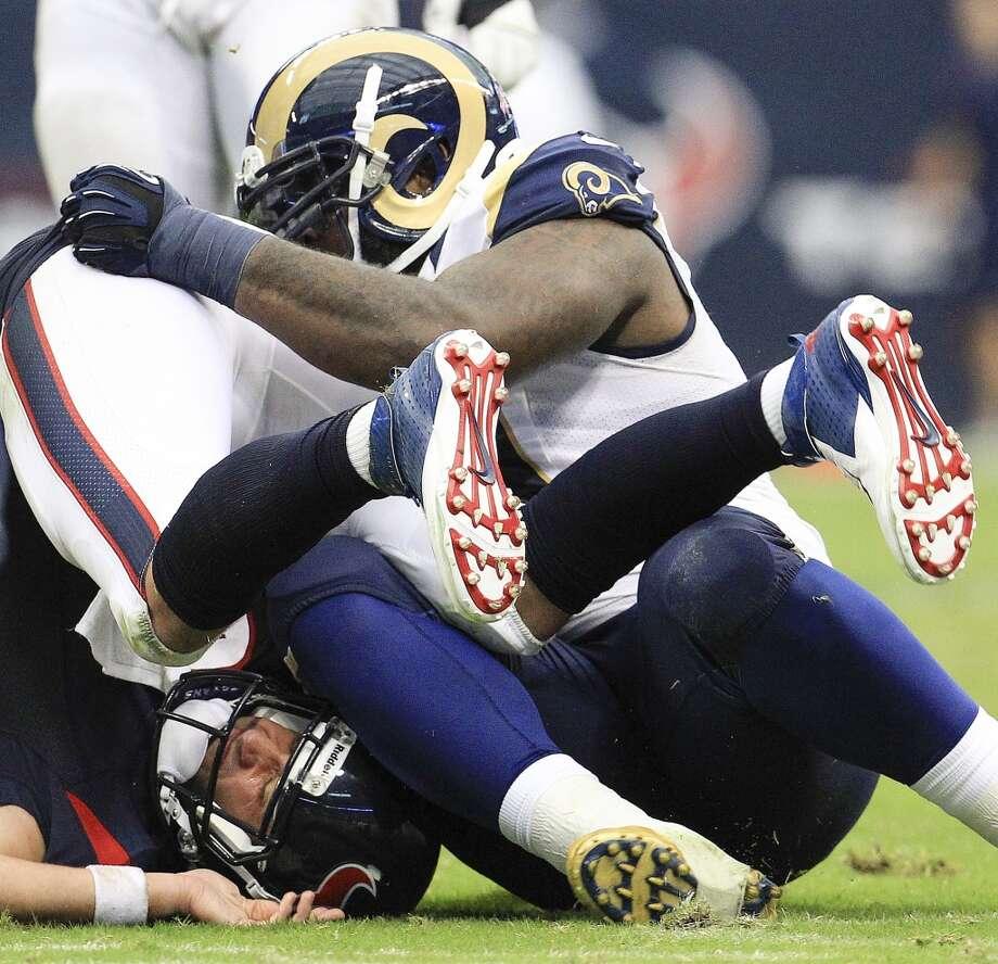 Texans quarterback Matt Schaub gets sacked by Rams defensive tackle Michael Brockers. Photo: Karen Warren, Houston Chronicle