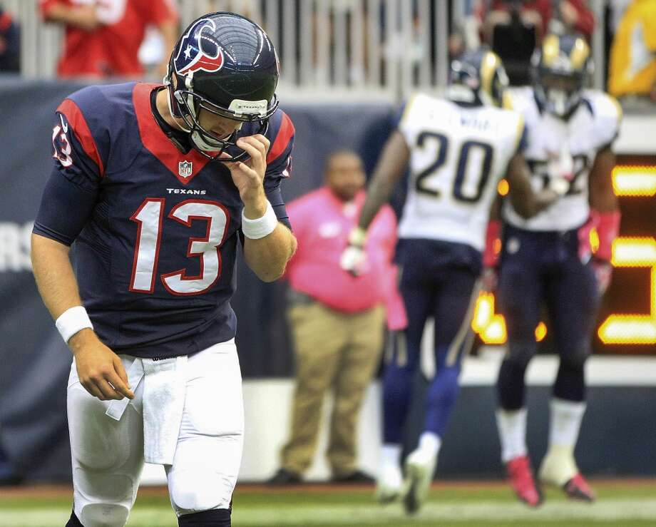Texans quarterback T.J. Yates reacts after throwing an interception that was returned for a touchdown by Rams linebacker Alec Ogletree. Photo: Karen Warren, Houston Chronicle