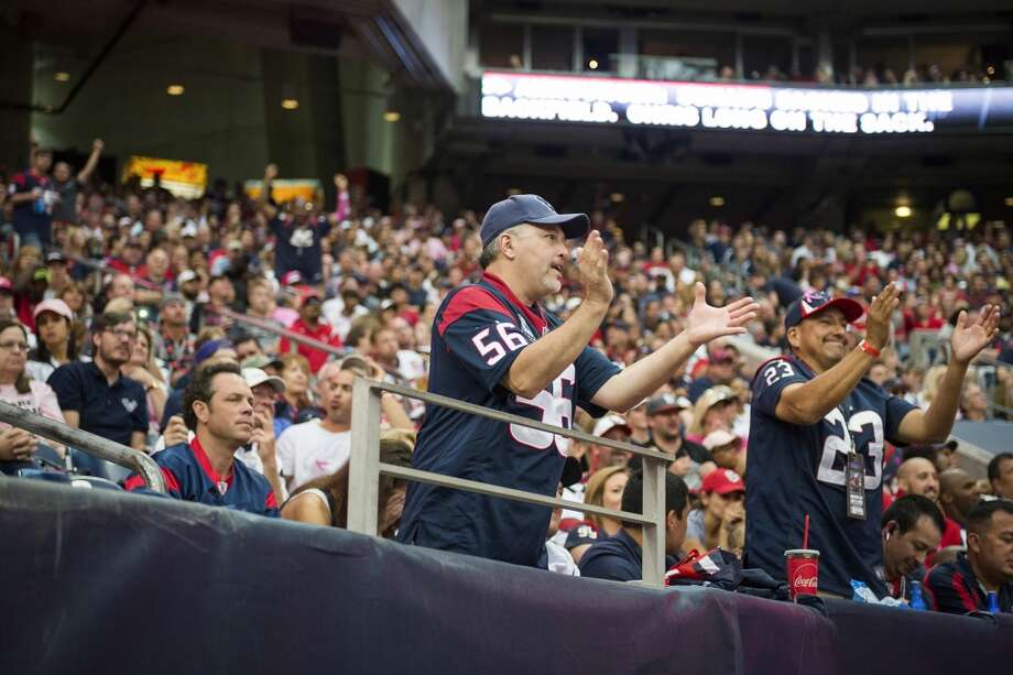 Texans fans cheer after an injury to quarterback Matt Schaub. Photo: Smiley N. Pool, Houston Chronicle