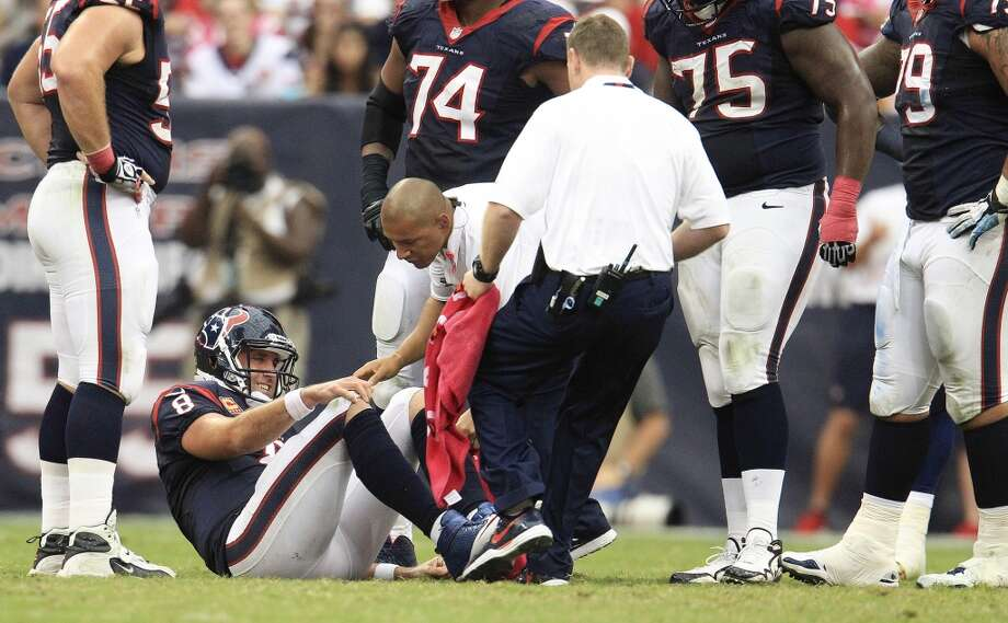 Texans quarterback Matt Schaub sits on the field injured after a play during the third quarter. Photo: Karen Warren, Houston Chronicle