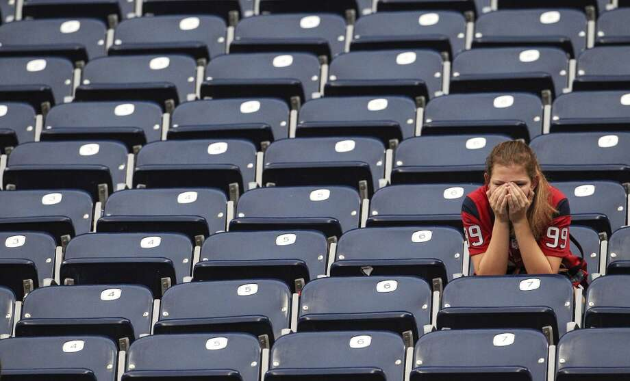A Texans fan sits in the stands after the loss against Rams. Photo: Karen Warren, Houston Chronicle